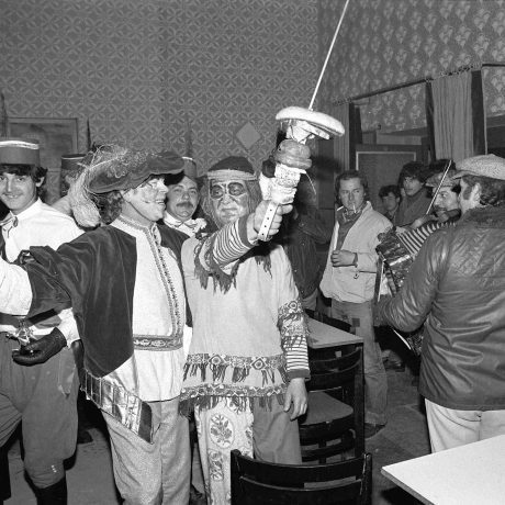 """Fašiangovníci """"Turci"""" s výslužkou na zábave. Šaštín. © Tibor Szabó, 1978"""